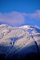 Ski hill after snowfall at twilight, in the mountains of Vancouver, BC.