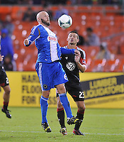 Connor Casey (6) of The Philadelphia Union goes against Perry Kirtchen (23) of D.C. United.  The Philadelphia Union tied D.C. United 1-1, at RFK Stadium, Saturday October 12 , 2013.