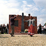 "A dance troupe from Bulgaria dances in front of the memorial for the Roma victims in the special Roma camp in Auschwitz - Birkenau. Despite a strong media presence, the 60th anniversary of ""Zigeuner nacht"" reached hardly any western media."