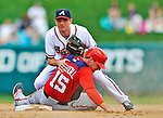 6 March 2012: Atlanta Braves' infielder Josh Wilson gets a sliding Brett Carroll out at second during a Spring Training game against the Washington Nationals at Champion Park in Disney's Wide World of Sports Complex, Orlando, Florida. The Nationals defeated the Braves 5-2 in Grapefruit League play. Mandatory Credit: Ed Wolfstein Photo