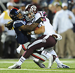 Texas A&amp;M quarterback Johnny Manziel (2) is tackled by Mississippi defensive back Charles Sawyer (3) in Oxford, Miss. on Saturday, October 6, 2012. (AP Photo/Oxford Eagle, Bruce Newman)..