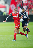 22 October 2011: Toronto FC forward Danny Koevermans #14 and New England Revolution defender Darrius Barnes #25 in action during a game between the New England Revolution and Toronto FC at BMO Field in Toronto..The game ended in a 2-2 draw.