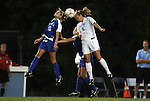 24 September 2009: Duke's Elisabeth Redmond (16) and North Carolina's Whitney Engen (9) challenge for a header. The University of North Carolina Tar Heels defeated the Duke University Blue Devils 2-1 in sudden victory overtime at Fetzer Field in Chapel Hill, North Carolina in an NCAA Division I Women's college soccer game.