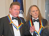Don Henley and Timothy B. Schmidt of the rock band &quot;Eagles&quot; speak to one another as they prepare to join others of the five recipients of the 39th Annual Kennedy Center Honors pose for a group photo following a dinner hosted by United States Secretary of State John F. Kerry in their honor at the U.S. Department of State in Washington, D.C. on Saturday, December 3, 2016.  The 2016 honorees are: Argentine pianist Martha Argerich; rock band the Eagles; screen and stage actor Al Pacino; gospel and blues singer Mavis Staples; and musician James Taylor.<br /> Credit: Ron Sachs / Pool via CNP
