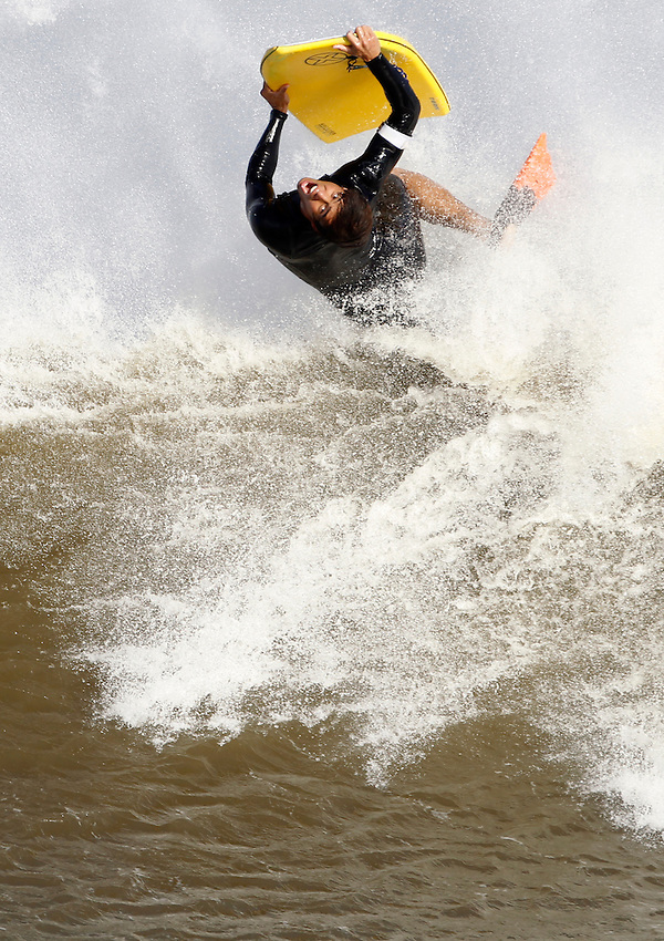 By late afternoon, the sun was out and a west wind created near-perfect surfing conditions at  Manasquan Beach as the back end of Hurricane Irene has passed through southern Monmouth County.   (8/28/2011)  Andrew Mills/The Star-Ledger