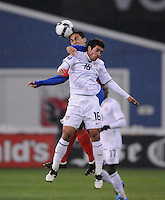 Costa Rica midfielder Randall Azofeita (14) jumps to head the ball against USMNT midfielder Benny Feihaber (16).  The USMNT tied Costa Rica 2-2 on the final game of the 2010 FIFA World Cup Qualifying round at RFK Stadium, Wednesday October 14, 2009.