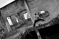 A Colombian parkour runner climbs inside a ruined house during a free running training session of Plus Parkour team in Bogotá, Colombia, 21 February 2016. Parkour, originally developed in France during the late 1980s from military training, is a physical activity, focused on the art of movement and overcoming obstacles in a strictly urban environment. Practitioners of parkour employ running, climbing, jumping, rolling and other movements to pass through any urban area the most efficient way possible.