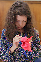 OrigamiUSA 2014. Kika Salgo folding a carousel designed by Torres, Buitrago, Donahue and taught by Leyla Torres.