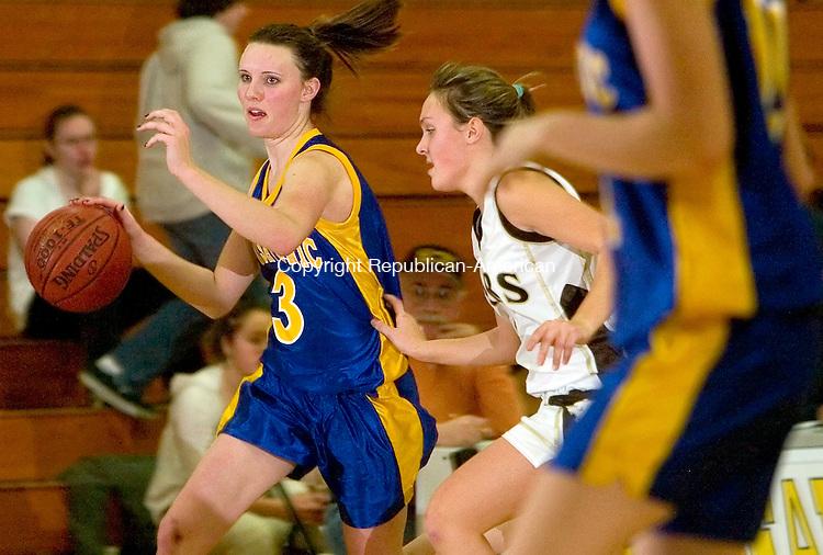 THOMASTON, CT-- 29  JANUARY 2008--012908JS07-THousatonic's Sawyer Thornton (3) drives past Thomaston's Brittany Brandt (1) during their game Tuesday at Thomaston High School. <br /> Jim Shannon/Republican-American