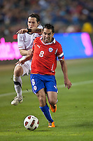 CARSON, CA – JANUARY 22: USA midfielder Mixx Diskerud (16) and Chile midfielder Fernando Meneses (8) during the international friendly match between USA and Chile at the Home Depot Center, January 22, 2011 in Carson, California. Final score USA 1, Chile 1.