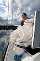 WA09118-00...WASHINGTON - Terry Donnelly sailing the waters off Vashon Island in the Puget Sound. (MR# D13)