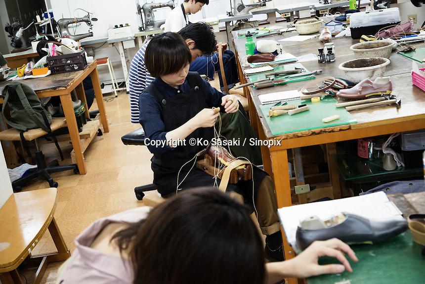 Students are making shoes at Sarukawa Footwear College