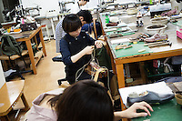 Students are making shoes at Sarukawa Footwear College