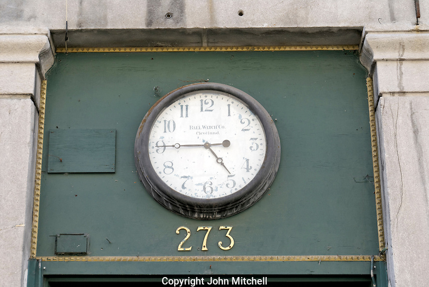 Old clock made by the Ball Watch Company in Cleavland above a doorway, Old Montreal, Quebec
