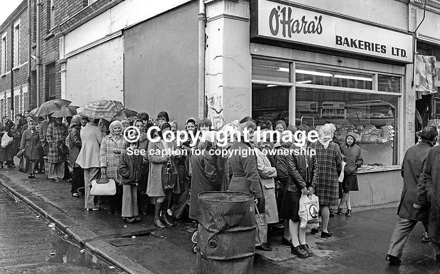 Women queue outside O'Hara's bakery shop on the Shankill Road, Belfast, N Ireland, during the United Unionist Action Committee, UUAC, strike which lasted from 3rd to 13th May 1977. 197705090157a<br /> <br /> Copyright Image from Victor Patterson, 54 Dorchester Park, Belfast, UK, BT9 6RJ<br /> <br /> Tel: +44 28 9066 1296<br /> Mob: +44 7802 353836<br /> Voicemail +44 20 8816 7153<br /> Email: victorpatterson@me.com<br /> Email: victorpatterson@gmail.com<br /> <br /> IMPORTANT: My Terms and Conditions of Business are at www.victorpatterson.com