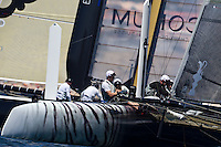 PORTUGAL, Cascais. 5th August 2011. America's Cup World Series. Practice day.  TEAM KOREA, with ENERGY TEAM in the background.