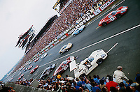 Start of Le Mans 24 hour race in 1967:  race was won by Dan Gurney and A. J. Foyt on theitr Ford GT 40 Mk IV red car No 1 at top right; white Chaparral in foreground.