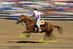 A woman barrel races at the Jordan Valley Big Loop Rodeo