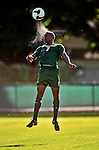 22 September 2008: University of Vermont Catamounts' forward T.J. Gore, a Junior from Macomb, MI, has the ball spray perspiration as he jumps high to head the ball during game action against the Colgate University Raiders at Centennial Field, in Burlington, Vermont. The Raiders edged out the Catamounts 2-1, handing the Soccer Catamounts their first home loss of the 2008 season. ..Mandatory Photo Credit: Ed Wolfstein Photo