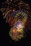 Fireworks display over Lake Union celebrating the 4th of July Independence Day Seattle Washington State USA.