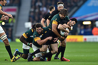 Nehe Milner-Skudder of New Zealand is tackled by Frans Malherbe and Lood de Jager of South Africa. Rugby World Cup Semi Final between South Africa and New Zealand on October 24, 2015 at Twickenham Stadium in London, England. Photo by: Patrick Khachfe / Onside Images