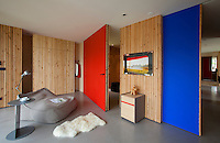 Guest rooms evolve according to requirement, with colourful sliding doors used to divide the space more intimately