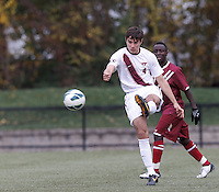 Virginia Tech defender Alessandro Mion (4) clears the ball. Boston College (maroon) defeated Virginia Tech (Virginia Polytechnic Institute and State University) (white), 3-1, at Newton Campus Field, on November 3, 2013.