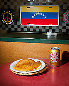Venezuelan street food courtesy of Dogs & Something Else; cachapa, a sweet corn pancake with white cheese, and a chicken empanada with a can of Materva, a soda made with yerba mate, Wake Forest, N.C., Wednesday, September 28, 2011.