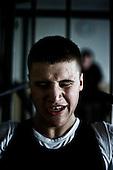 Warsaw 04.2009 Poland<br /> One of the boksers during training.<br /> Since the early 50' ties &quot;Gwardia&quot; has been famous for bringing up world boxing champions. The famed sports hall located by pl. Zelaznej Bramy in Warsaw witnessed trainings of Jerzy Kulej, the Skrzeczowie brothers, last Polish olympic champion Jerzy Rybicki or its most recent star Krzysztof &quot;Diablo&quot; Wlodarczyk. The club prides of numerous sport achievements, among others, 15 olympic medals (6 gold), over 60 medals from European and World Championships and over 100 from Championships of Poland.<br /> Today, only three small training halls remain from the former times of glory.<br /> One of the most famous in Polish history boxing section of Warsaw's &quot;Gwardia&quot; awaits its liquidation. This &quot;Mecca&quot; of Polish boxing is to be replaced by a huge supermarket,  decisions imposed by Warsaw authorities.<br /> ( Photo: Adam Lach / Napo Images )<br /> <br /> Jeden z bokserow podczas treningu.<br /> Juz od wczesnych lat 50. Gwardia slynela z wychowywania swiatowych mistrzow bokserskich. W hali przy pl. Zelaznej Bramy trenowali Jerzy Kulej, bracia Skrzeczowie, ostatni polski mistrz olimpijski w boksie Jerzy Rybicki czy obecna gwiazda ringu Krzysztof &quot;Diablo&quot; Wlodarczyk. Klub moze poszczycic sie wieloma osiagnieciami sportowymi, do kt&oacute;rych przede wszystkim zaliczyc nalezy: 15 medali olimpijskich (w tym 6 zlotych), ponad 60 medali Mistrzostw Swiata i Europy i ponad 1000 medali Mistrzostw Polski. Teraz z dawnej swietnosci pozostaly zaledwie trzy male salki. Jedna z najslyniejszych w historii Polski sekcja bokserska Gwardii Warszawa ma byc zlikwidowana. Decyzja wladz Warszawy, te swego rodzaju mekke polskiego boksu ma zastapic wielki market<br /> (Fot Adam Lach / Napo Images )