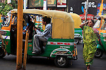 Asia, India, Calcutta.  A woman and taxi on streets of Calcutta.