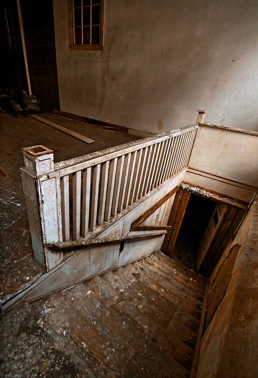 Old decaying stairway in warehouse