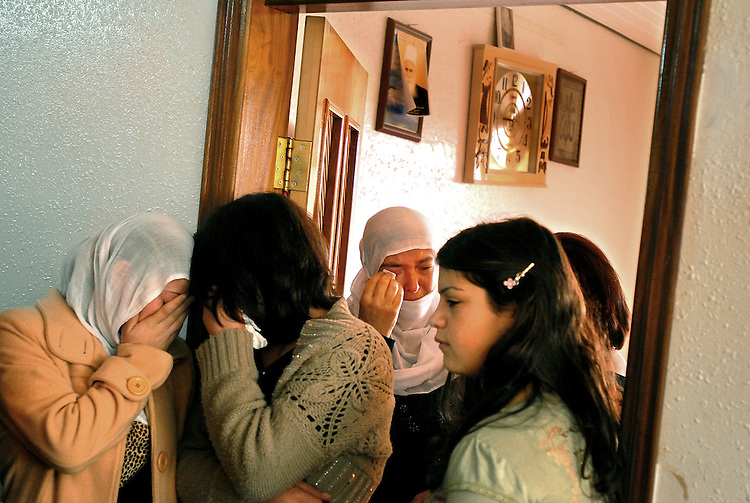 Relatives of Arwad Abu Shaheen weep during her wedding day, as they participate in a farewell gathering at Arwad's house in Bukata, Golan Heights, before she is set off to marry her fiancé in Syria.