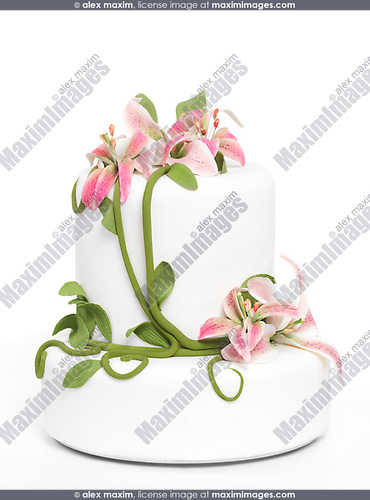 Fancy cake with lilies isolated on white background
