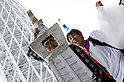 May 22, 2011, Tokyo, Japan - Men wear a costume of Tokyo Sky Tree. Tokyo Skytree, the world's tallest self-standing telecommunications tower with a height of 634 meters, opens today. This new Japanese landmark is expected to attract approximately 200,000 visitors on this first official opening day to the general public. (Photo by Yumeto Yamazaki/Nippon News)