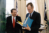 United States President George H.W. Bush meets with new Chief of Staff Samuel K. Skinner the Oval Office of the White House in Washington, DC on December 16, 1991.<br /> Mandatory Credit: David Valdez / White House via CNP