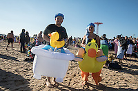 BROOKlLYN, NY - JANUARY 01 : A couple wearing costumes  take part in the annual Coney Island Polar Bear Club New Year's Day swim by running into the ocean at Coney Island , Brooklyn on January 01, 2017. Photo by VIEWpress/Maite H. Mateo.