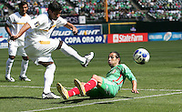 Carlos Alonzo (5) kicks the ball before Luis Miguel Noriega's (19) slide tackle. Mexico defeated Nicaragua 2-0 during the First Round of the 2009 CONCACAF Gold Cup at the Oakland, Coliseum in Oakland, California on July 5, 2009.