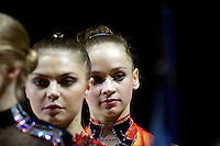 (R) Marina Shpekt of Russia is in focus with fellow team member ((L) Alina Kabaeva turns during All-Around awards at 2006 Thiais Grand Prix in Paris, France on March 25, 2006.  (Photo by Tom Theobald)