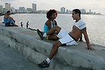 Cubans relax along the famous 7km long Malecon sea wall bulit during the U.S occupation in 1901 that faces the Florida Straits in Havana,Cuba.