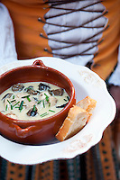Briancon, Hautes Alpes, France, July 2013. Creamy snail soup. Traditional food in a tradional setting at restaurant La Caponniere. The walled city of Briancon is full of narrow streets filled with medieval houses and many shops, restaurants and bars. The Hautes Alpes region is made of valleys, lakes, canyons and mountains going from the northern Alps to the Provence and ranges from 500m to 4302m  in altitude. Endowed with an exceptional beauty the Hautes Alpes has managed to keep clear of industry and large crowds. The atmosphere has stayed casual and convivial. There is an alpine feeling in this area due to its steep slopes and the abundance of mountain villages. Photo by Frits Meyst/Adventure4ever.com