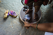 An Accredited Social Health Activist (ASHA) worker monitors the weight of an infants at the local health centre in Gorikothapally Village in Warangal district in Andhra Pradesh, India.