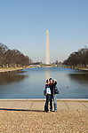Washington DC; USA: The Reflecting Pool on the National Mall, with the Washington Monument in the background.  Couple photographing themselves..Photo copyright Lee Foster Photo # 5-washdc76116