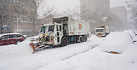 Dept. of Sanitation trucks plow West 26th Street, a secondary roadway, in Chelsea in New York during Winter Storm Jonas on Saturday, January 23, 2016.  (© Richard B. Levine)