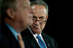 Senator CHUCK SCHUMER (D-NY) listens as Senator DICK DURBIN (D-IL) speaks during a news conference on disaster relief funding on Capitol Hill on Thursday.