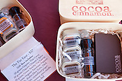 December 3, 2011. Durham, NC.. Gift boxes of pure cocoa, spices and chocolates were available..  Areli Barrera de Grodski and Leon Grodski de Barrera are the owners of Cocoa Cinnamon, a specialty chocolate shop, as well as bikeCoffee, a bicycle powered mobile coffee shop.
