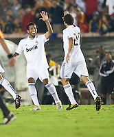 Real defender Ezequiel Garay (19) high fives Real forward Gonzalo Higuain (20) during the second half of the friendly game between LA Galaxy and Real Madrid at the Rose Bowl in Pasadena, CA, on August 7, 2010. LA Galaxy 2, Real Madrid 3.