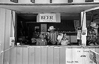 Beer sellers wait for the customers at the annual Lincoln Rodeo in Lincoln, MT in June 2006.  The Lincoln Rodeo is an open rodeo, which means competitors need not be a member of a professional rodeo association.