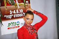 """Melitina Staniouta of Belarus smiles to cameras at """"kiss & cry"""" during event finals at 2010 Holon Grand Prix at Holon, Israel on September 4, 2010.  (Photo by Tom Theobald)."""