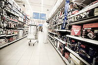 Qatar - Doha -  Qatari man shopping at Carrefour in City Center Mall