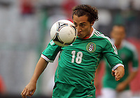 MEXICO CITY, MEXICO - AUGUST 15, 2012:  Andres Guardado (18) of  Mexico during an international friendly match against the USA at Azteca Stadium, in Mexico City, Mexico on August 15. USA won 1-0.